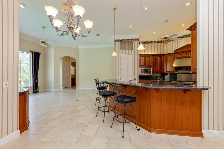 Real Estate Photography - 240 Eagle Estates, Debary, FL, 32713 - Family Room / Kitchen