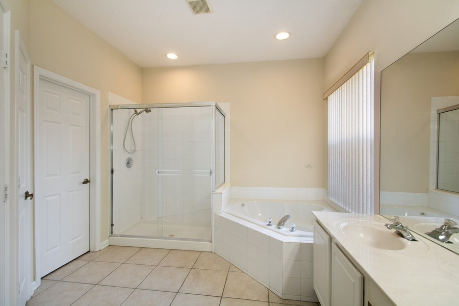 Real Estate Photography - 648 Caledonia Pl, Sanford, FL, 32771 - Master Bathroom