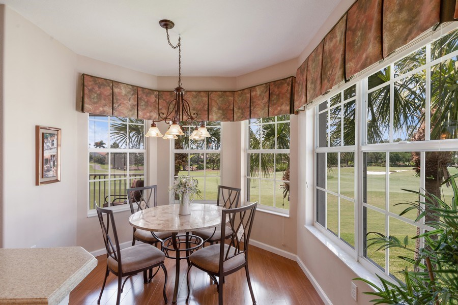 Real Estate Photography - 4655 Winged Foot Court Unit 204, Naples, FL, 34112 - Dining Area