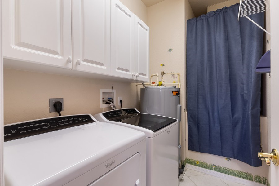 Real Estate Photography - 4655 Winged Foot Court Unit 204, Naples, FL, 34112 - Laundry Room