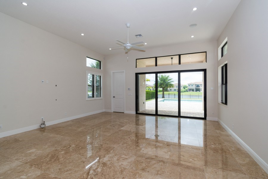 Real Estate Photography - 10262 Sweet Bay Manor, Parkland, FL, 33076 - Family room off Kitchen