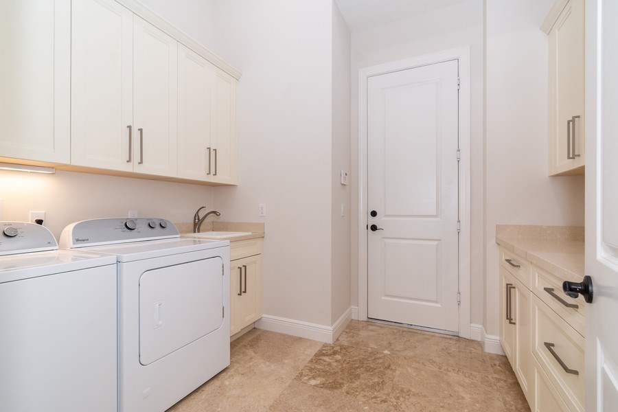 Real Estate Photography - 10262 Sweet Bay Manor, Parkland, FL, 33076 - Laundry Room