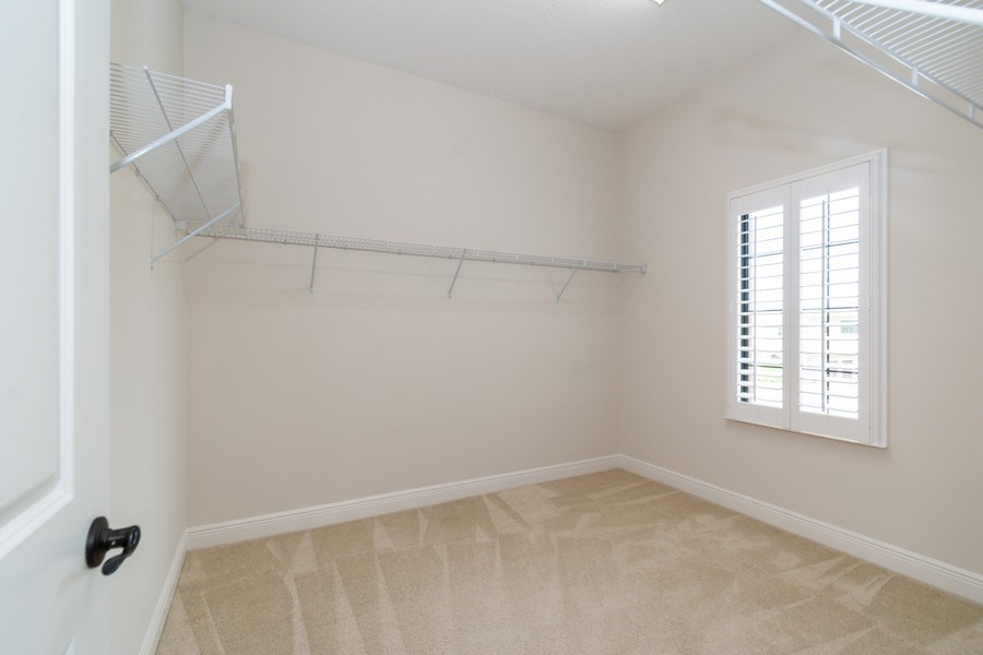 Real Estate Photography - 10262 Sweet Bay Manor, Parkland, FL, 33076 - Master Bedroom Closet (Hers)