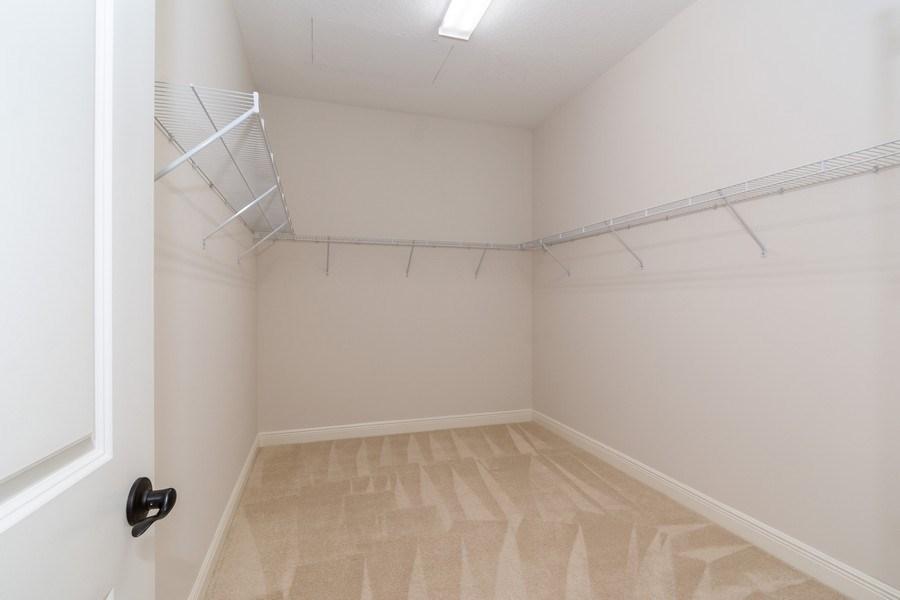 Real Estate Photography - 10262 Sweet Bay Manor, Parkland, FL, 33076 - Master Bedroom Closet (His)
