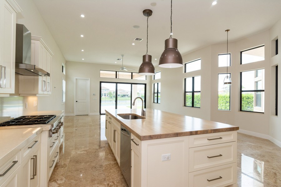 Real Estate Photography - 10262 Sweet Bay Manor, Parkland, FL, 33076 - Family Room / Kitchen