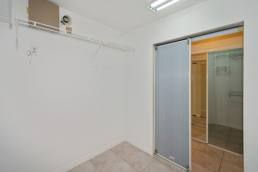 Real Estate Photography - 5333 NW 109TH WAY, CORAL SPRINGS, FL, 33076 - Master Bedroom Closet