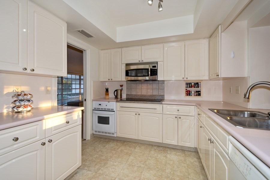 Real Estate Photography - 17 Cayuga Road, Sea Ranch Lakes, FL, 33308 - Kitchen