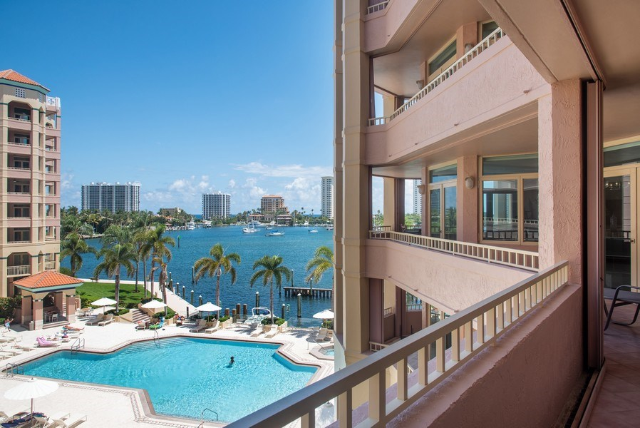 Real Estate Photography - 300 SE 5th Avenue, Unit #4080, Boca Raton, FL, 33432 - Balcony view of Lake Boca Raton and ocean beyond
