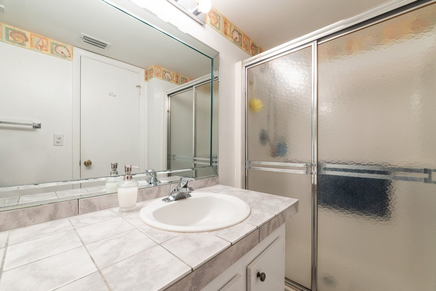 Real Estate Photography - 7190 Golf Colony Ct, 104, Lake Worth, FL, 33467 - Master Bathroom