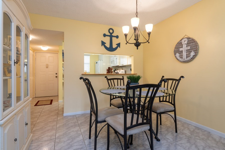 Real Estate Photography - 7190 Golf Colony Ct, 104, Lake Worth, FL, 33467 - Foyer/Dining Room