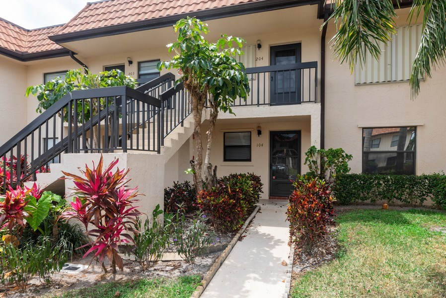 Real Estate Photography - 7190 Golf Colony Ct, 104, Lake Worth, FL, 33467 - Front View