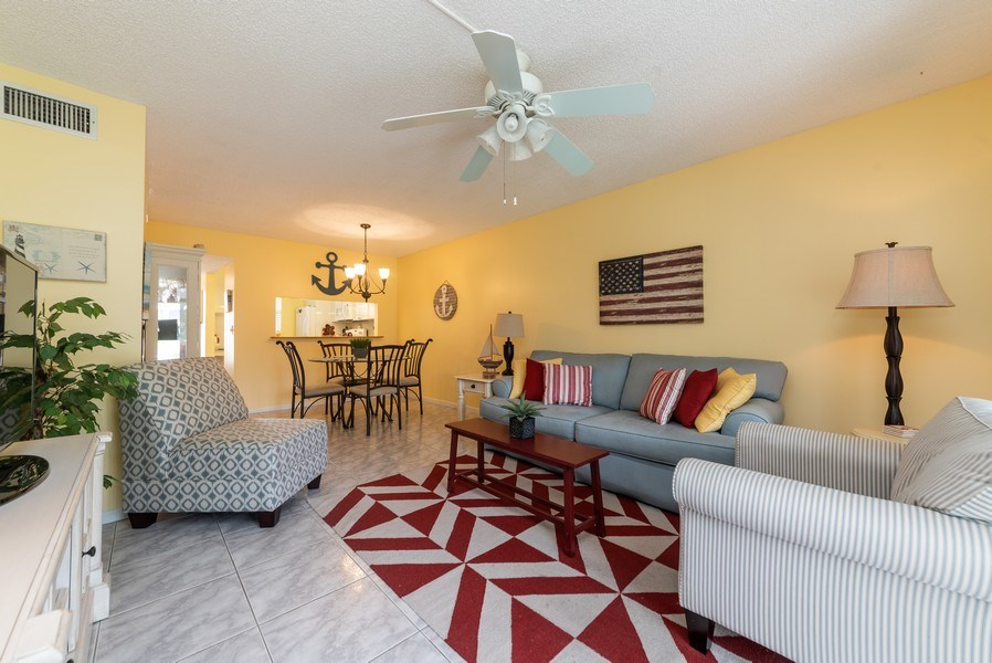 Real Estate Photography - 7190 Golf Colony Ct, 104, Lake Worth, FL, 33467 - Living Room/Dining Room