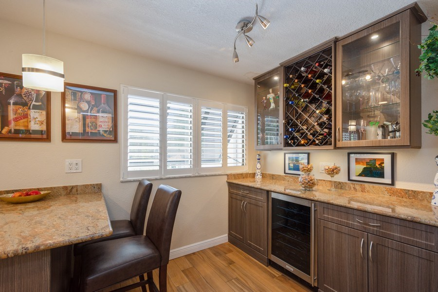 Real Estate Photography - 13914 Lake Point Dr, Clearwater, FL, 33762 - Wine Cellar