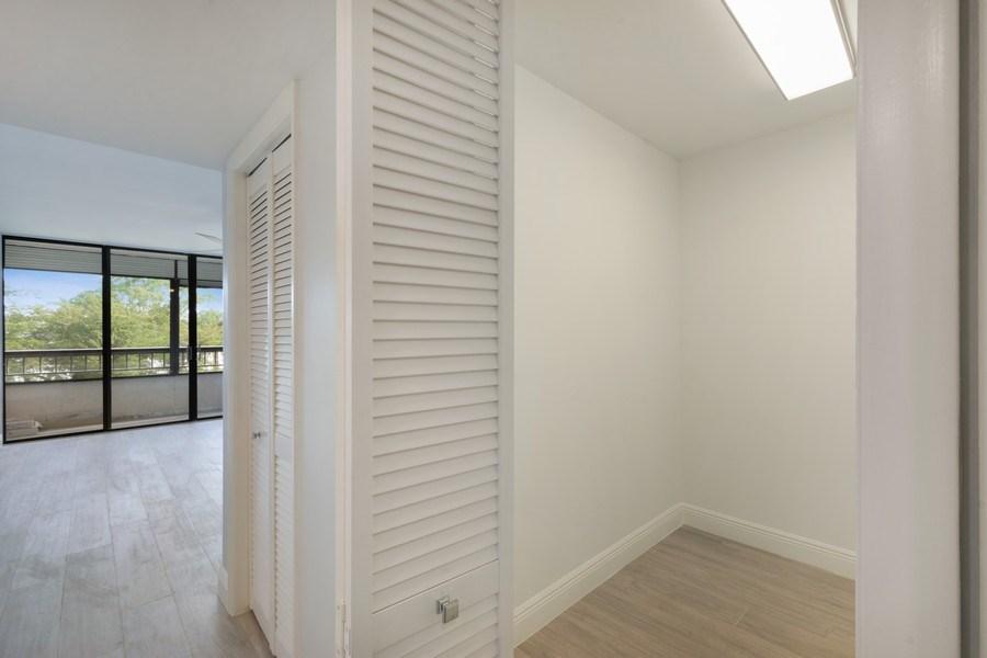 Real Estate Photography - 6320 Boca Del Mar Dr, Unit 307, Boca Raton, FL, 33433 - Master Bedroom Closet