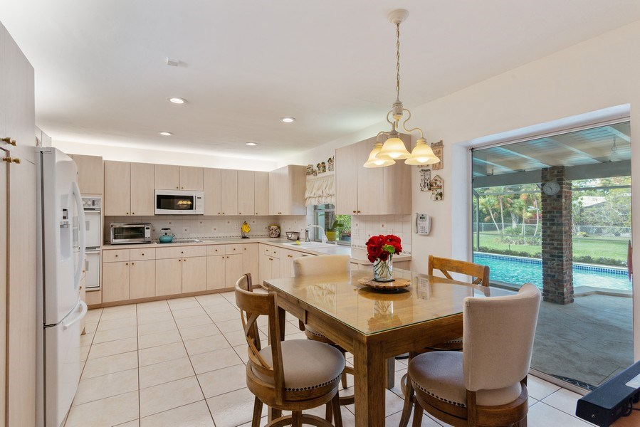 Real Estate Photography - 14300 SW 73rd Ave, Palmetto Bay, FL, 33158 - Kitchen / Breakfast Room