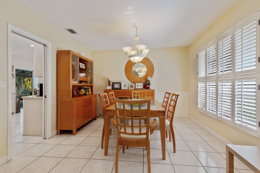 Real Estate Photography - 14300 SW 73rd Ave, Palmetto Bay, FL, 33158 - Kitchen / Dining Room