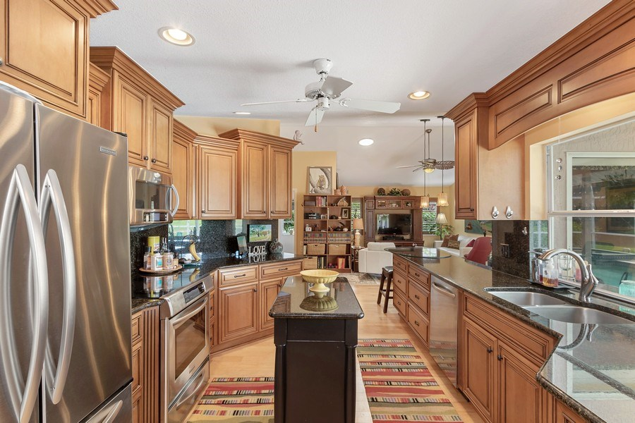 Real Estate Photography - 6520 Highland Pines Circle, Fort Myers, FL, 33966 - Kitchen