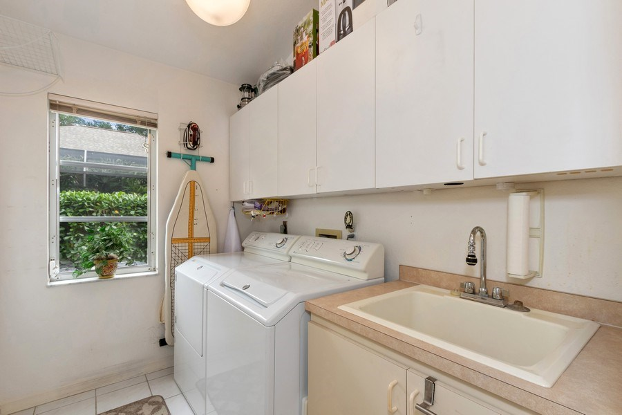 Real Estate Photography - 6520 Highland Pines Circle, Fort Myers, FL, 33966 - Laundry Room