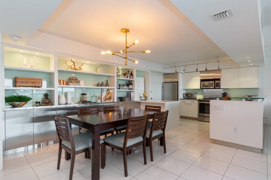 Real Estate Photography - 1 Grove Isle Dr, Unit# A306, Miami, FL, 33133 - Dining Room