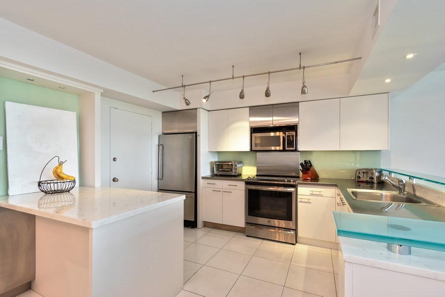 Real Estate Photography - 1 Grove Isle Dr, Unit# A306, Miami, FL, 33133 - Kitchen