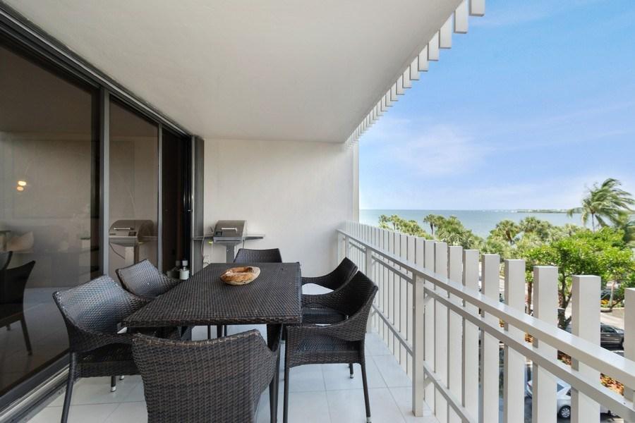 Real Estate Photography - 1 Grove Isle Dr, Unit# A306, Miami, FL, 33133 - Balcony