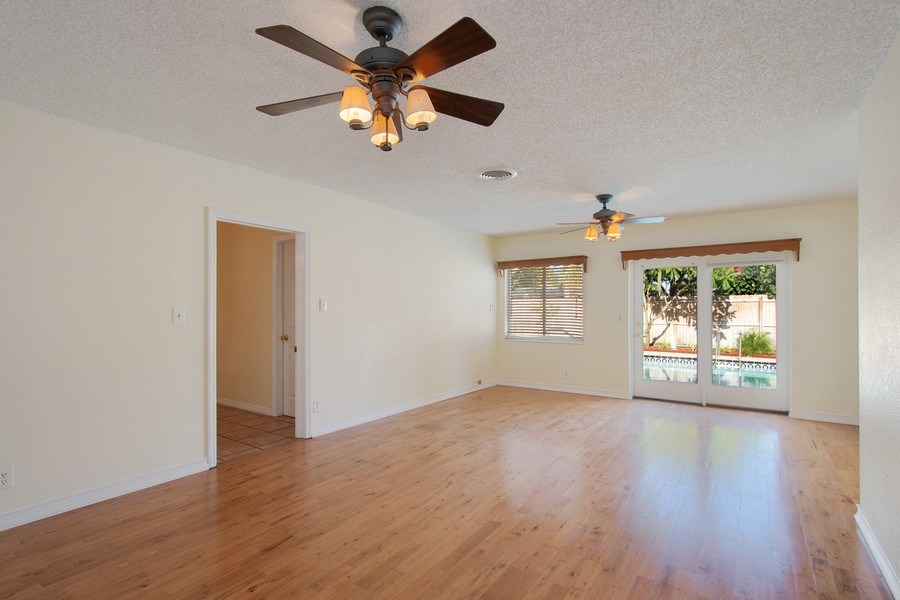 Real Estate Photography - 4146 Indianapolis Street NE, St Petersburg, FL, 33703 - Featuring REAL WOOD FLOORS & 2 CEILING FANS!