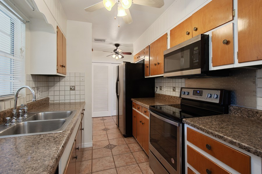Real Estate Photography - 4146 Indianapolis Street NE, St Petersburg, FL, 33703 - 16' Kitchen w/Stainless Steel Appliances + PANTRY