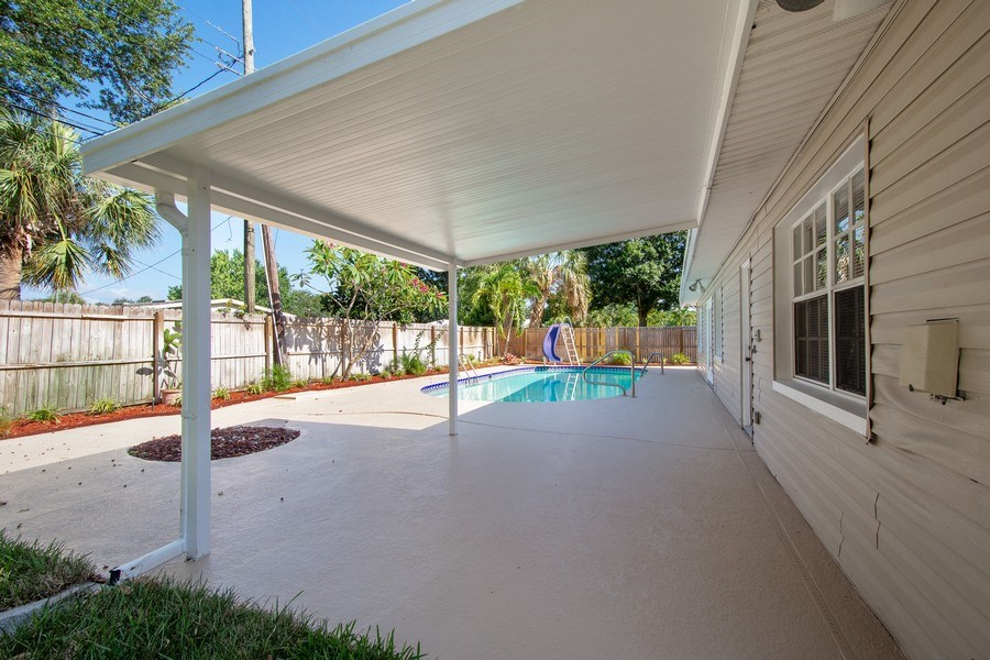 Real Estate Photography - 4146 Indianapolis Street NE, St Petersburg, FL, 33703 - 12'x12' ROOFED LANAI & FIRE PIT overlooking POOL!
