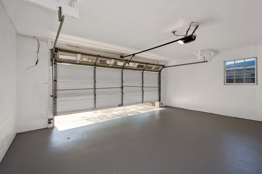 Real Estate Photography - 4146 Indianapolis Street NE, St Petersburg, FL, 33703 - Garage has Automatic Door Opener
