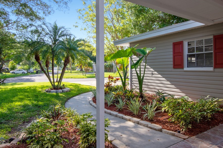 Real Estate Photography - 4146 Indianapolis Street NE, St Petersburg, FL, 33703 - Garden Walk leads to Front Roofed Porch!