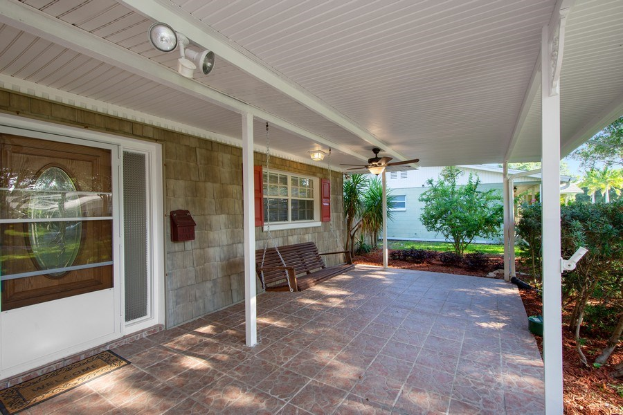 Real Estate Photography - 4146 Indianapolis Street NE, St Petersburg, FL, 33703 - VERY Welcoming Front Porch for family & friends!