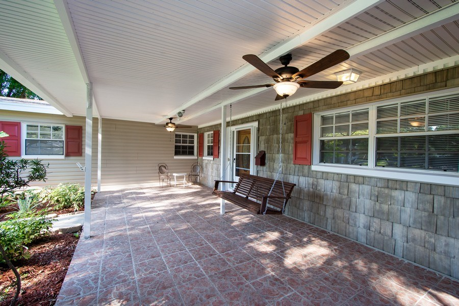 Real Estate Photography - 4146 Indianapolis Street NE, St Petersburg, FL, 33703 - Relaxing WOODEN PORCH SWING + 2 CEILING FANS!