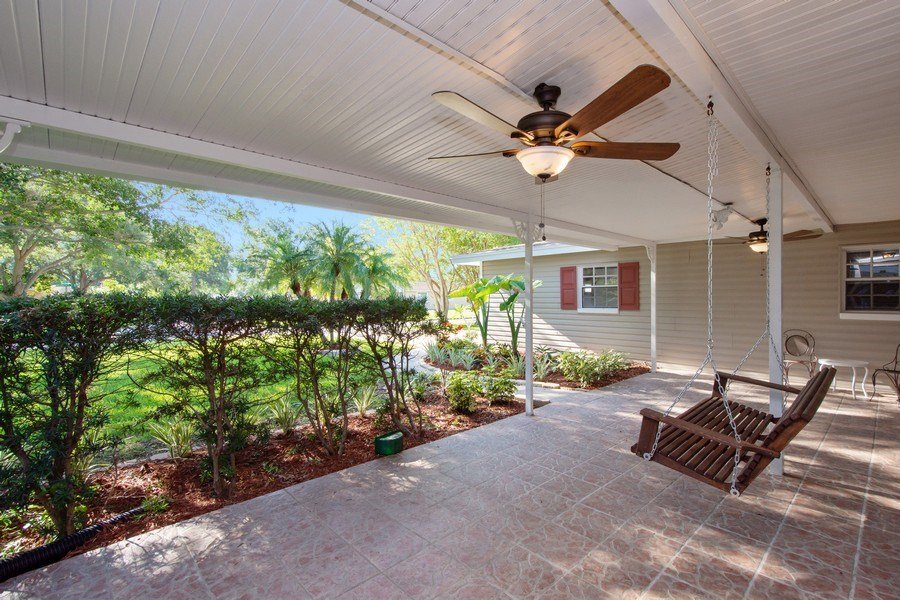 Real Estate Photography - 4146 Indianapolis Street NE, St Petersburg, FL, 33703 - Inviting 29' x 12' ROOFED FRONT PORCH!