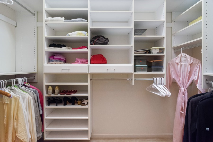 Real Estate Photography - 405 NW Springview Loop, Port St. Lucie, FL, 34986 - Master Bedroom Closet