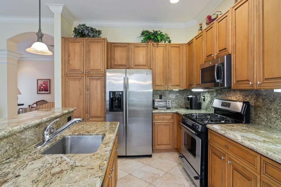 Real Estate Photography - 405 NW Springview Loop, Port St. Lucie, FL, 34986 - Kitchen