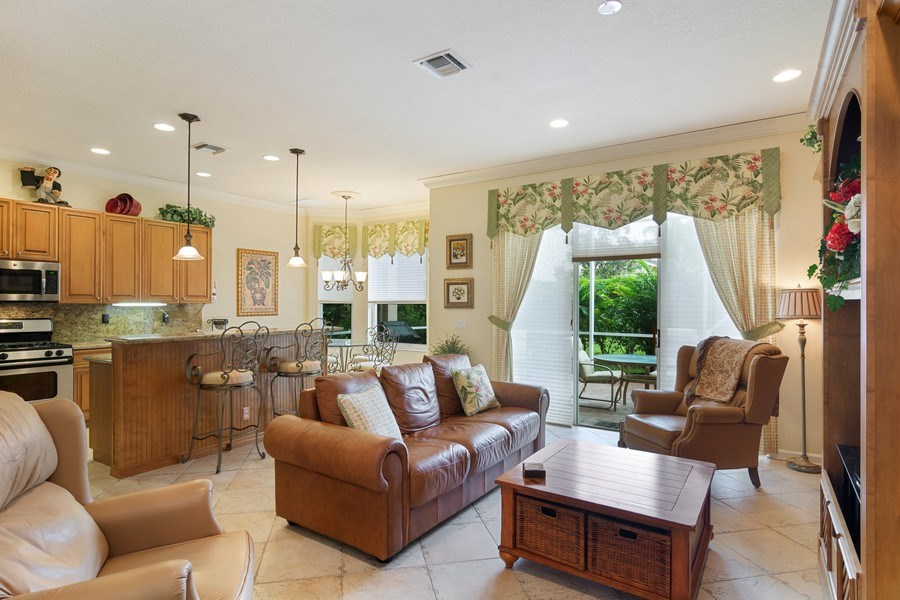 Real Estate Photography - 405 NW Springview Loop, Port St. Lucie, FL, 34986 - Family Room / Kitchen
