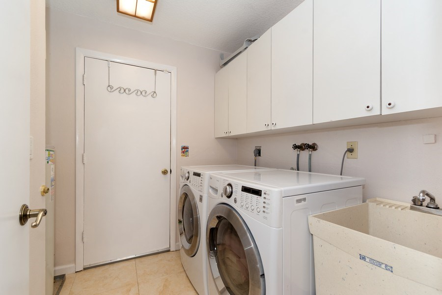 Real Estate Photography - 1430 NW 99th Ave, Plantation,, FL, 33322 - Laundry Room