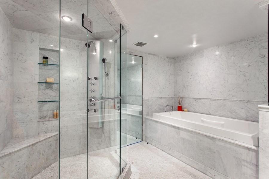 Real Estate Photography - 3 Grove Isle Dr. #C601, Miami, FL, 33133 - #32 Master Bathroom
