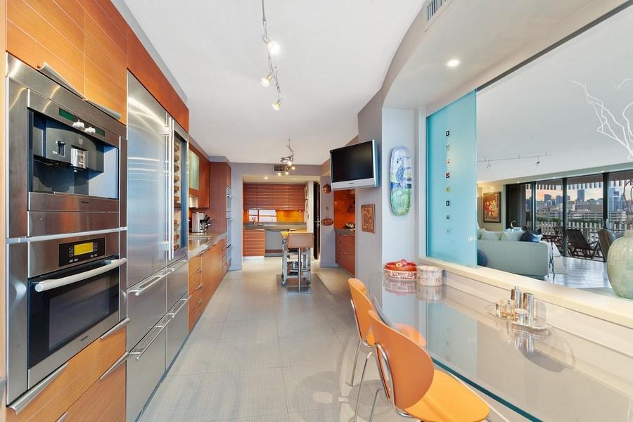Real Estate Photography - 3 Grove Isle Dr. #C601, Miami, FL, 33133 - #13 New Kitchen + Breakfast Room