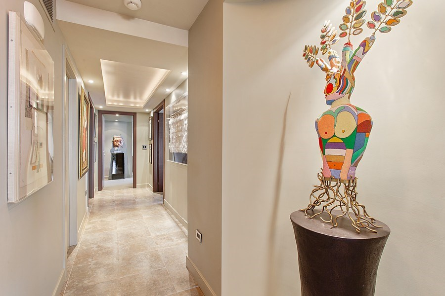 Real Estate Photography - 3 Grove Isle Dr. #C601, Miami, FL, 33133 - #23 Hallway with art