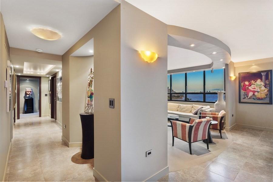 Real Estate Photography - 3 Grove Isle Dr. #C601, Miami, FL, 33133 - #24 New Hallway + Den