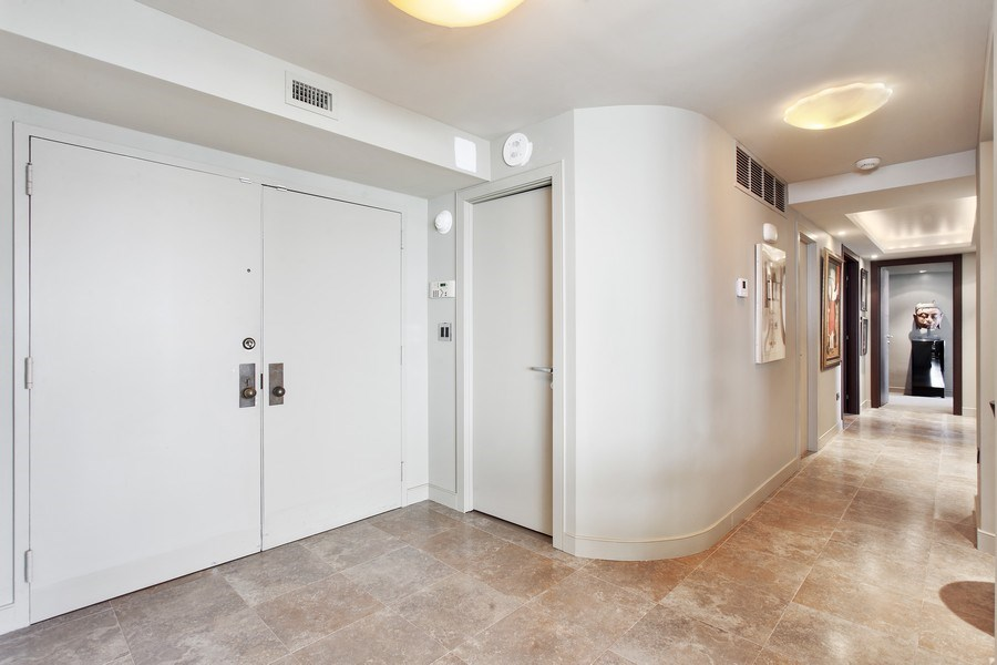 Real Estate Photography - 3 Grove Isle Dr. #C601, Miami, FL, 33133 - #1 Entryway