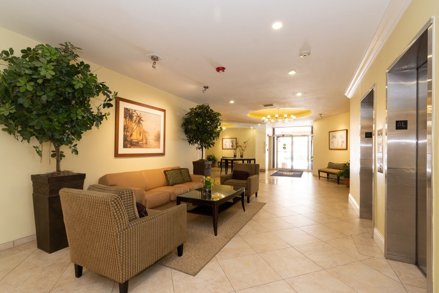 Real Estate Photography - 1301 River Reach Dr, Unit 211, Fort Lauderdale, FL, 33315 - Lobby