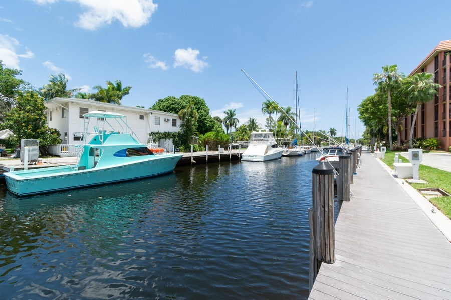 Real Estate Photography - 1301 River Reach Dr, Unit 211, Fort Lauderdale, FL, 33315 - Dock