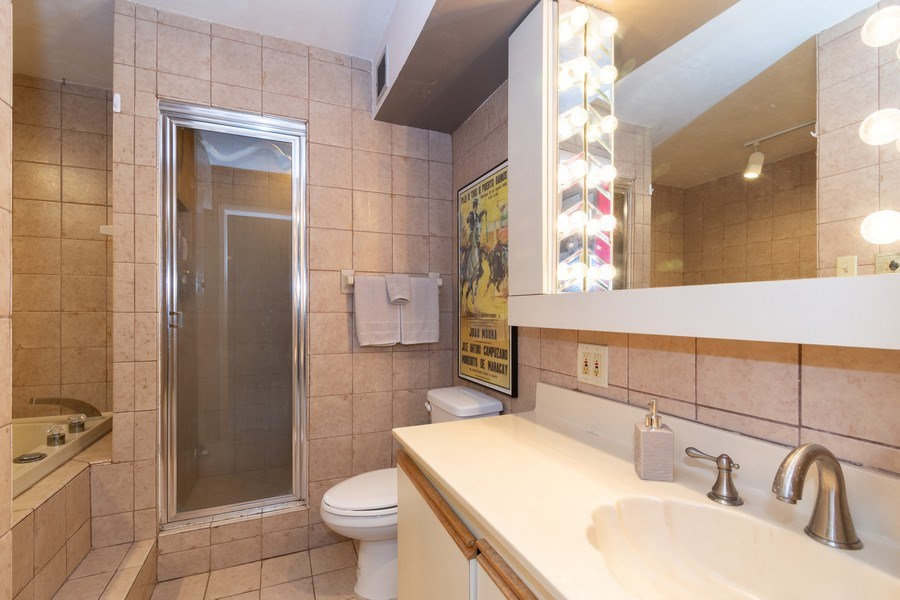 Real Estate Photography - 1301 River Reach Dr, Unit 211, Fort Lauderdale, FL, 33315 - Master Bathroom