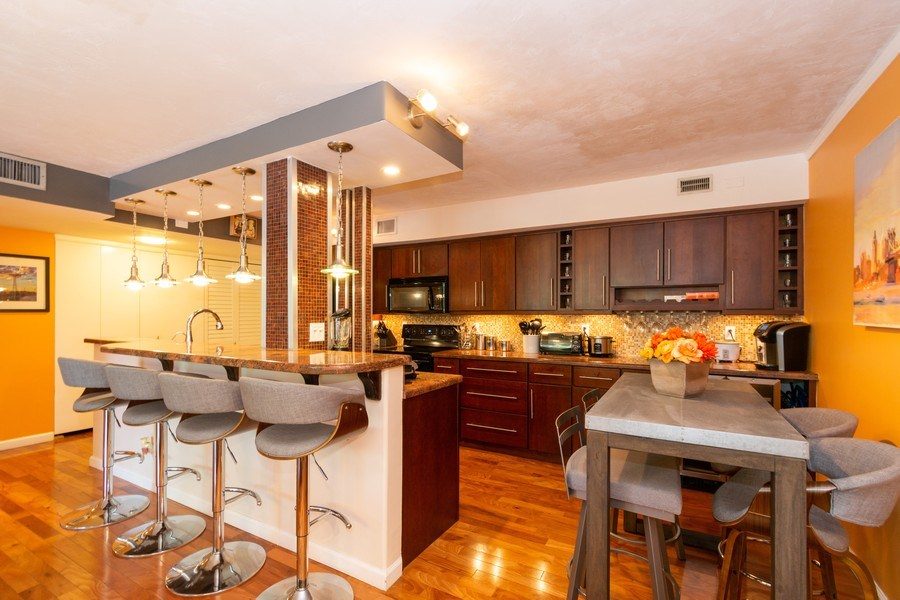 Real Estate Photography - 1301 River Reach Dr, Unit 211, Fort Lauderdale, FL, 33315 - Kitchen / Breakfast Room