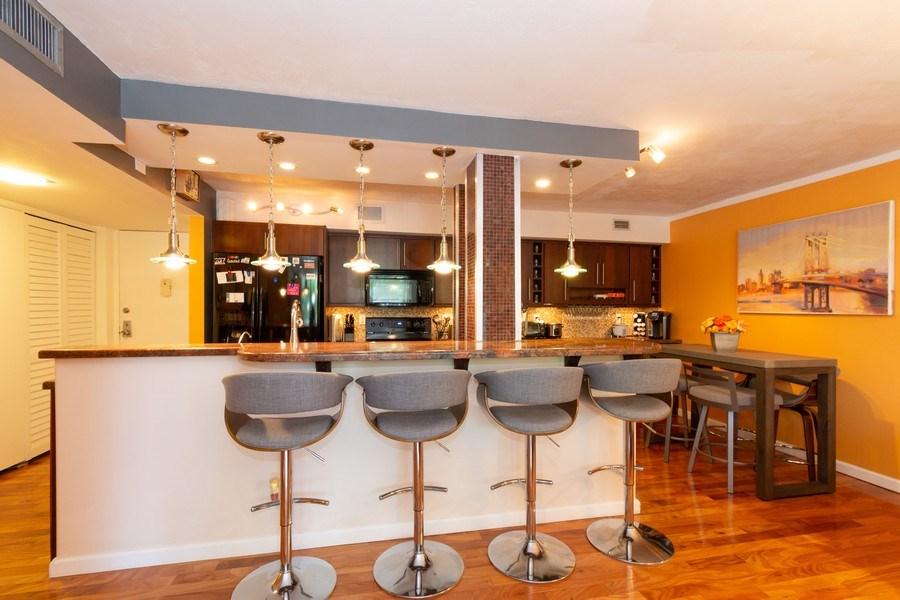 Real Estate Photography - 1301 River Reach Dr, Unit 211, Fort Lauderdale, FL, 33315 - Kitchen