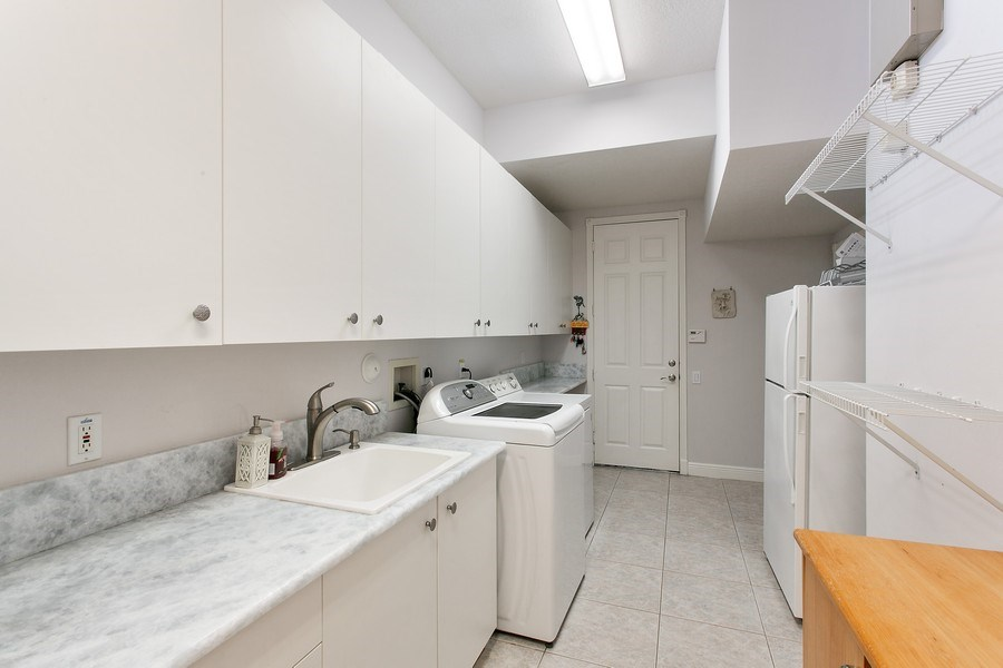 Real Estate Photography - 735 Charlestown Circle, Palm Beach Gardens, FL, 33410 - Laundry Room