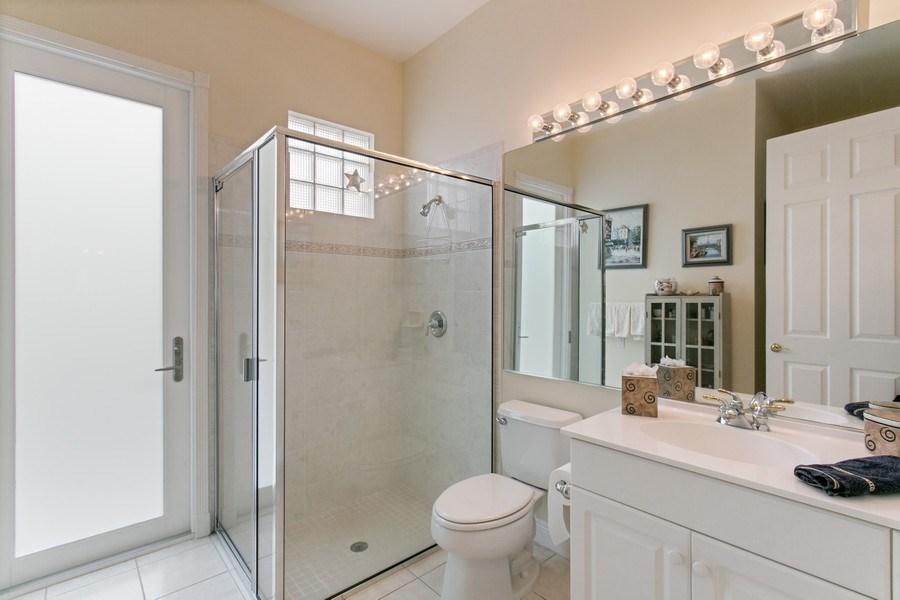 Real Estate Photography - 735 Charlestown Circle, Palm Beach Gardens, FL, 33410 - Cabana Bath/ First floor bathroom