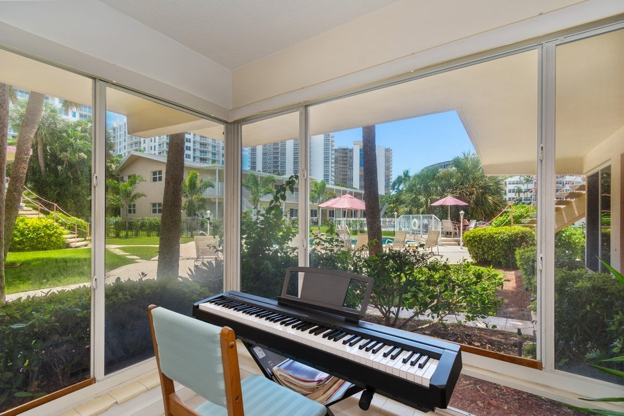 Real Estate Photography - 2825 NE 33rd Ave, Unit 103, Fort Lauderdale, FL, 33308 - Living Room